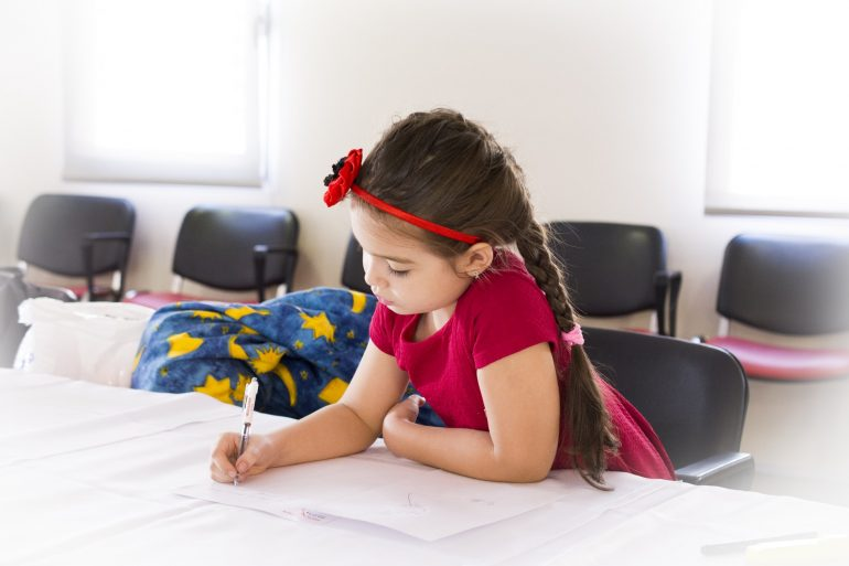 Girl Writing On Paper