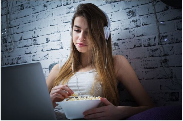 Girl using laptop and headphones