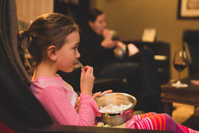 Girl with popcorn movie night