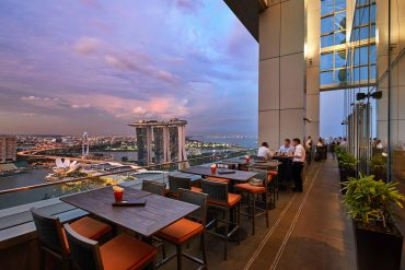best rooftop restaurant in singapore level 33 outdoor patio evening sky