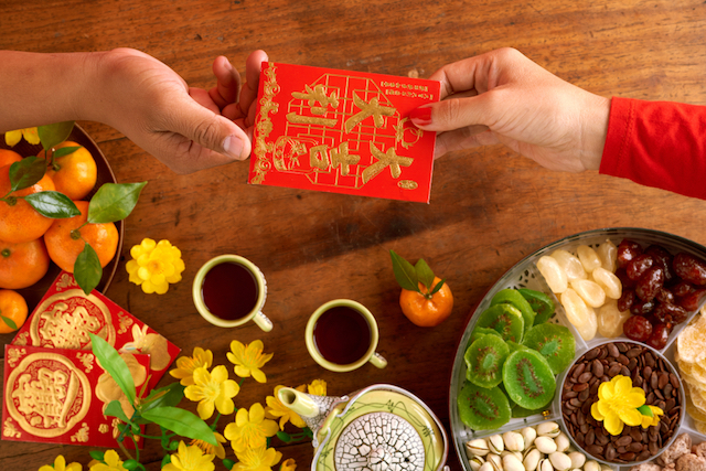 exchanging chinese new year greeting ang bao