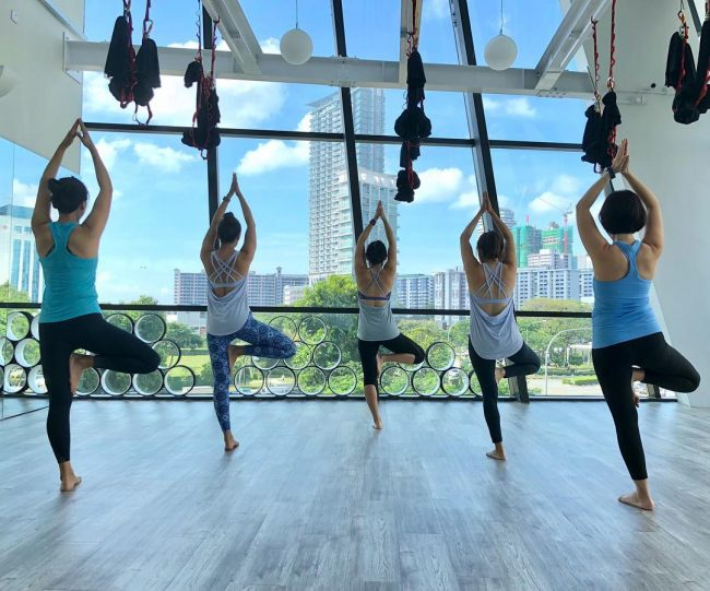 trium fitness tree pose aromatherapy yoga classes singapore