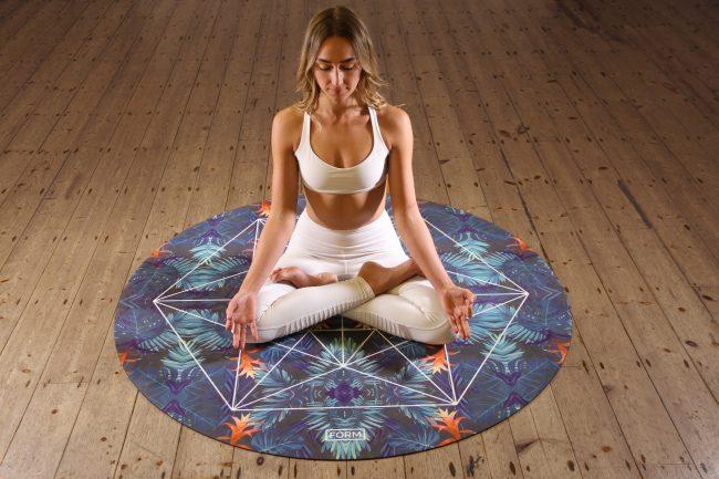 woman round circle yoga mat pose