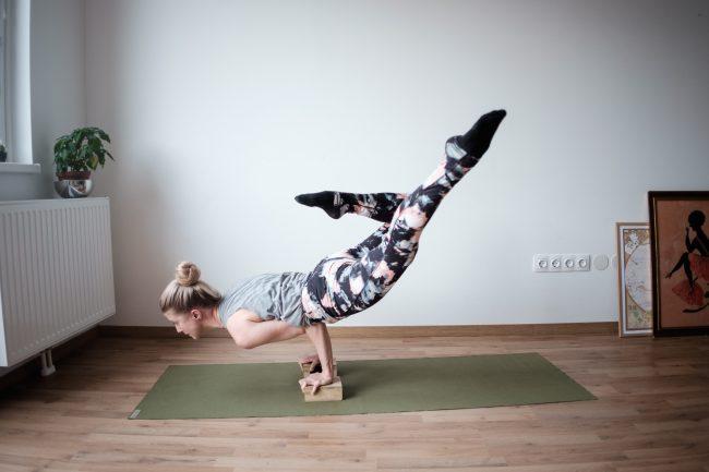 woman yoga mat green blocks props