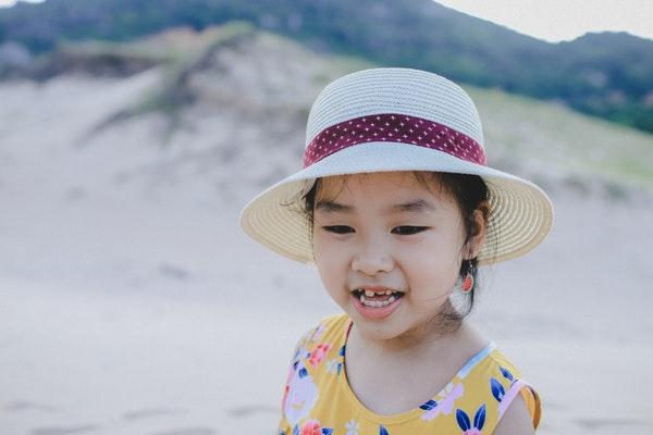 ear piercing for kids method singapore girl with watermelon earrings