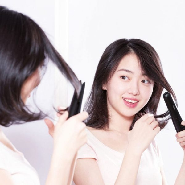 straightening hair with best hair straightener in singapore