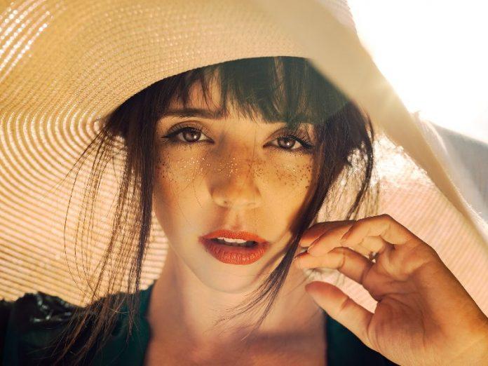 summer glow golden girl with hat beach glowy skin