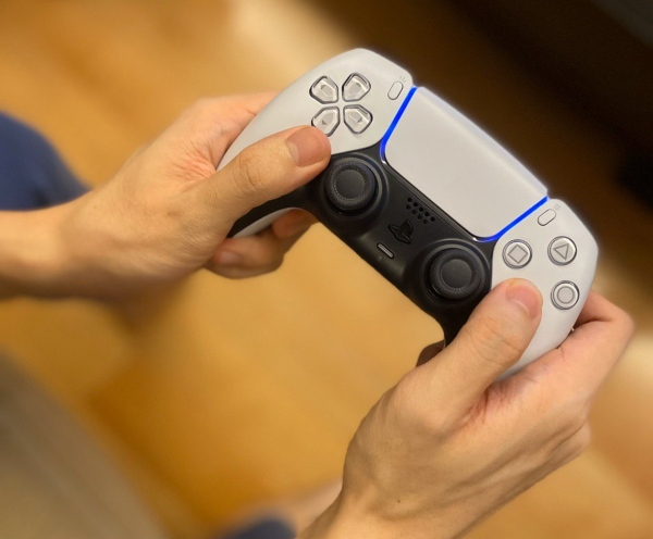 dualsense being held ps5 review