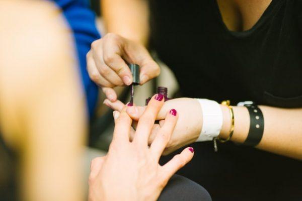 manicurist painting nails polish